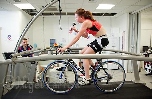 22 MAR 2012 - LOUGHBOROUGH, GBR - British triathlete Lucy Hall trains in the Performance Lab at Loughborough University watched by British Triathlon's Performance Coach Mark Pearce .(PHOTO (C) 2012 NIGEL FARROW)