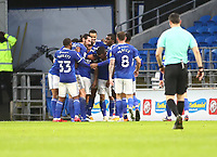 26th December 2020; Cardiff City Stadium, Cardiff, Glamorgan, Wales; English Football League Championship Football, Cardiff City versus Brentford; Will Vaulks of Cardiff City celebrates with team mates after scoring his sides first goal from his own half by managing to lob David Raya of Brentford making it 1-0 at the end of the first half