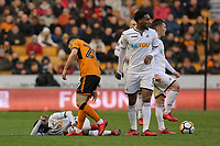 Ruben Vinagre of Wolverhampton Wanderers (C) check on Nathan Dyer of Swansea City who is lying on the ground injured during the Emirates FA Cup match between Wolverhampton Wanderers and Swansea City at The Molineux Stadium, Wolverhampton, England, UK. Saturday 06 January 2018