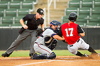 Rome Braves catcher Ryan Query (25) applies the tag to Joey DeMichele (17) of the Kannapolis Intimidators at home plate against the Kannapolis Intimidators at CMC-Northeast Stadium on August 5, 2012 in Kannapolis, North Carolina.  The Intimidators defeated the Braves 9-1.  (Brian Westerholt/Four Seam Images)