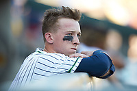 Drew Waters (11) of the Gwinnett Stripers watches from the dugout during the game against the Scranton/Wilkes-Barre RailRiders at Coolray Field on August 17, 2019 in Lawrenceville, Georgia. The Stripers defeated the RailRiders 8-7 in eleven innings. (Brian Westerholt/Four Seam Images)
