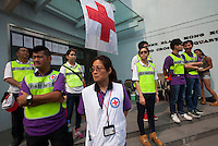 Red Cross workers stand by on day three of the mass civil disobedience campaign Occupy Central, Hong Kong, China, 30 September 2014.