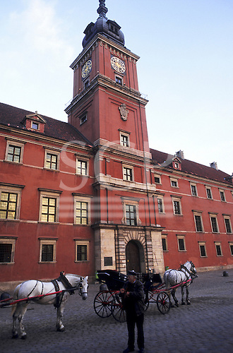 Warsaw, Poland. Horse-drawn carriages for tourists in the Old Town in front of the Royal Palace.