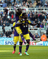 Pictured: Wilfried Bony of Swansea celebrating his goal with team mate Marvin Emnes, he from the penalty spot after the former was brought dowin in the box in stoppage time. Saturday 19 April 2014<br /> Re: Barclay's Premier League, Newcastle United v Swansea City FC at St James Park, Newcastle, UK.