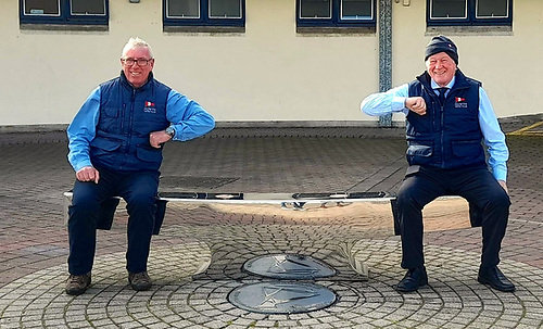 "Outgoing HYC Commodore Ian Byrne (left) and his successor Paddy Judge demonstrating the Two Metre Rule on HYC's popular ""cleat seat""."