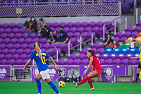 ORLANDO, FL - FEBRUARY 24: Jordyn Listro #21 of the CANWNT kicks the ball during a game between Brazil and Canada at Exploria Stadium on February 24, 2021 in Orlando, Florida.