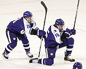 Matt Vidal (HC - 19) and Castan Sommer (HC - 15) celebrate Sommer's goal. - The visiting College of the Holy Cross Crusaders defeated the Boston College Eagles 5-4 on Friday, November 29, 2013, at Kelley Rink in Conte Forum in Chestnut Hill, Massachusetts.
