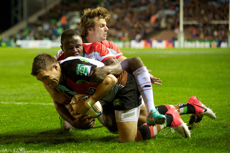 Seb Stegman of Harlequins forces his way through Taku Ngwenya of Biarritz Olympique during the Heineken Cup match between Harlequins and Biarritz Olympique Pays Basque at the Twickenham Stoop on Saturday 13th October 2012 (Photo by Rob Munro)