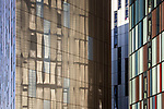 © Joel Goodman - 07973 332324 . 27/02/2014 . Manchester , UK . Abstract view of the three towers that make up Manchester's Parkway Gate accommodation scheme on Chester Street , in Manchester City Centre as bright spring sunshine reflects the colours of one tower on to another . Photo credit : Joel Goodman