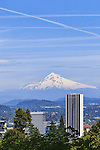Mount Hood seen over downtown Portland, Oregon from the Portland Japanese Garden. The Japanese Garden in Portland is a 5.5 acre respit.  Said to be one of the most authentic Japanese Garden's outside of Japan, the rolling terrain and water features symbolize both peace and strength.