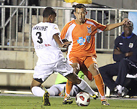 Kupono Low #3 Of the Carolina Railhawks tackles Richard Martinez #3 of the Puerto Rico Islanders during the second leg of the USSF-D2 championship match at WakeMed Soccer Park, in Cary, North Carolina on October 30 2010. The game ended 1-1, Puerto Rico won on overall goals 3-1.