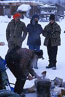 Visitors Watch C Boulding fix Food Kaltag Iditarod 99 AK