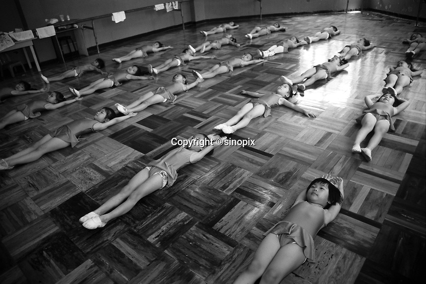 """Girls at ballet lesson at the """"Children's Palace"""" in Shenzhen, China. The single children are doted upon are often referred to as """"Little Emperors"""".<br /> May 1999<br /> <br /> photo by Richard Jones / Sinopix"""