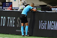 ATLANTA, GA - AUGUST 29: Referee Nima Saghafi checks the VAR replay during a game between Orlando City SC and Atlanta United FC at Marecedes-Benz Stadium on August 29, 2020 in Atlanta, Georgia.