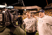Pitt head coach Dave Wannstedt (left) gets congratulated by defensive line coach Greg Gattuso after The Pitt Panthers upset the West Virginia Mountaineers 13-9 on December 01, 2007 in the 100th edition of the Backyard Brawl at Mountaineer Field, Morgantown, West Virginia.