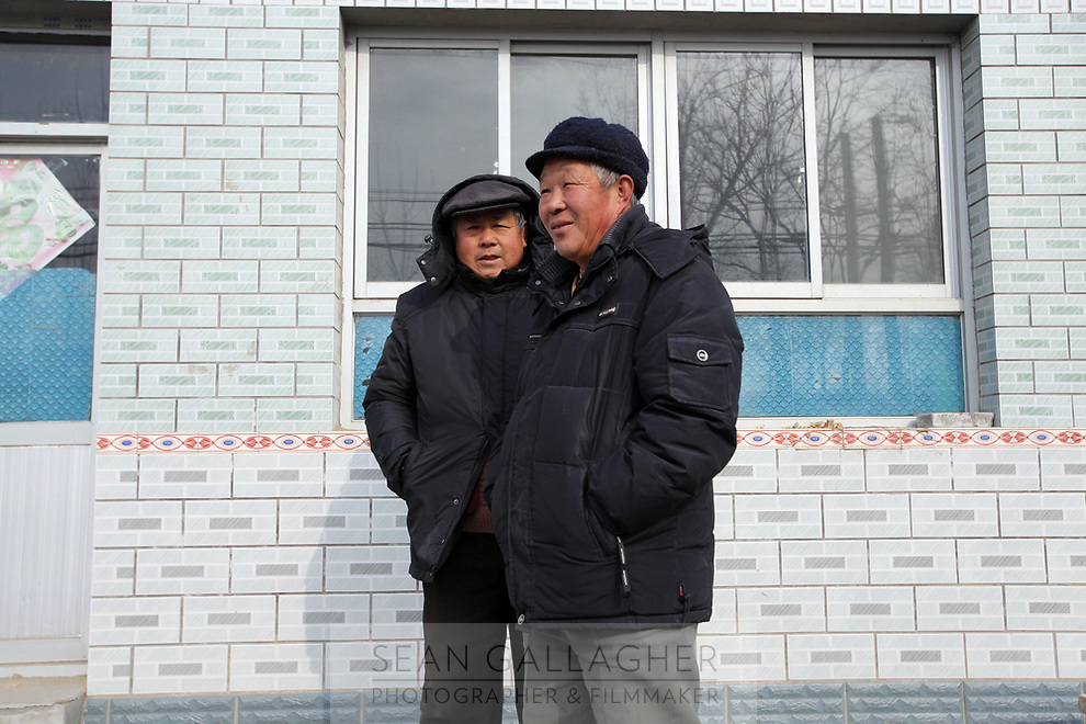 Villagers in Dongzhuangying Village, on the southern outskirts of Beijing. Villagers have been building new extensions to their properties in-light of news that their village will be destroyed to make way for a new city airport. Villagers will be compensated more depending on the area of their homes, resulting in new buildings appearing across the village, as villagers anticipate higher amounts of compensation from local government. China. Friday 25th January, 2013.