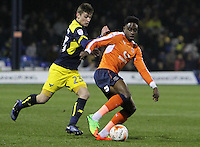 Pelly-Ruddock Mpanzu of Luton Town in action with Ryan Ledson of Oxford United during the The Checkatrade Trophy Semi Final match between Luton Town and Oxford United at Kenilworth Road, Luton, England on 1 March 2017. Photo by Stewart  Wright  / PRiME Media Images.
