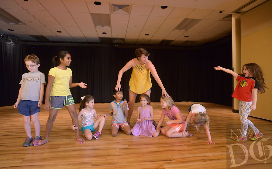 NWA Democrat-Gazette/BEN GOFF @NWABENGOFF<br /> Elise Hallof, a teaching artist with Trike Theatre, leads campers in an improv exercise on Monday July 11, 2016 during Camp Trike Theatre: Improv & Comedy at the Bentonville Community Center. The campers will present a short comedy performance for their families on Friday at the conclusion of the five-day camp.