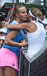March 31 2016: Svetlana Kuznetsova (RUS) hugs Timea Bacsinszky (SUI) after winning at the Miami Open being played at Crandon Park Tennis Center in Miami, Key Biscayne, Florida. ©Karla Kinne/Tennisclix/Cal Sports Media
