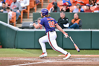 Clemson Tigers left fielder Reed Rohlman (26) swings at a pitch during a game against the Maine Black Bears at Doug Kingsmore Stadium on February 20, 2016 in Clemson, South Carolina. The Tigers defeated the Black Bears 9-4. (Tony Farlow/Four Seam Images)