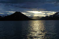 "Midnight and setting sun on ""Chocolate Drop"" mountain, Halo Bay, Katmai National Park, Alaskan Peninsula, Alaska"