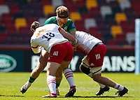 24th April 2021; Brentford Community Stadium, London, England; Gallagher Premiership Rugby, London Irish versus Harlequins; Harry Elrington of London Irish tackled by Will Collier and Joe Marchant of Harlequins