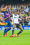 Jose Paulo Bezerra Maciel Junior, Paulinho, of FC Barcelona competes for the ball with Daniel Parejo Munoz of Valencia CF during the La Liga 2017-18 match between Valencia CF and FC Barcelona at Estadio de Mestalla on November 26 2017 in Valencia, Spain. Photo by Maria Jose Segovia Carmona / Power Sport Images