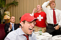 Switzerland fans Oliver Tremblet and (L-R) Ben, Alex Kerguen, and Julien Turnare cheer on their team in its match against France on June 13, 2006 at Opia, a New York City restaurant.<br /> <br /> The World Cup, held every four years in different locales, is the world's pre-eminent sports tournament in the world's most popular sport, soccer (or football, as most of the world calls it).  Qualification for the World Cup is open to any country with a national team accredited by FIFA, world soccer's governing body. The first World Cup, organized by FIFA in response to the popularity of the first Olympic Games' soccer tournaments, was held in 1930 in Uruguay and was participated in by 13 nations.    <br /> <br /> As of 2010 there are 208 such teams.  The final field of the World Cup is narrowed down to 32 national teams in the three years preceding the tournament, with each region of the world allotted a specific number of spots.  <br /> <br /> The World Cup is the most widely regularly watched event in the world, with soccer teams being a source of national pride.  In most nations, the whole country is at a standstill when their team is playing in the tournament, everyone's eyes glued to their televisions or their ears to the radio, to see if their team will prevail.  While the United States in general is a conspicuous exception to the grip of World Cup fever there is one city that is a rather large exception to that rule.  In New York City, the most diverse city in a nation of immigrants, the melting pot that is America is on full display as fans of all nations gather in all possible venues to watch their teams and celebrate where they have come from.