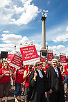 """© Joel Goodman - 07973 332324 - all rights reserved . 03/07/2010 . London , UK . People carry placards reading """" Equality under the law """" as the march passes through Trafalgar Square . Annual London Pride march and demonstration through the centre of London . Photo credit : Joel Goodman"""