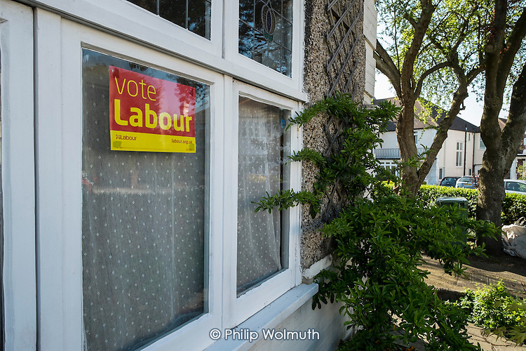 Labour Party election poster on a house in Hampstead and Kilburn, the second most marginal constituency in the UK, held by Labour with a majority of 42 at the 2010 general election.