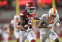 Arkansas wide receiver Mike Woods (8) carries the ball for  a score, Saturday, November 7, 2020 during the third quarter of a football game at Donald W. Reynolds Razorback Stadium in Fayetteville. Check out nwaonline.com/201108Daily/ for today's photo gallery. <br /> (NWA Democrat-Gazette/Charlie Kaijo)