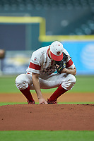 Louisiana Ragin' Cajuns starting pitcher Nick Lee (6) writes in the dirt behind the mound prior to the start of the game against the Mississippi State Bulldogs in game three of the 2018 Shriners Hospitals for Children College Classic at Minute Maid Park on March 2, 2018 in Houston, Texas.  The Bulldogs defeated the Ragin' Cajuns 3-1.   (Brian Westerholt/Four Seam Images)