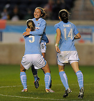 April 25, 2009 Boston Breakers vs. Chicago Red Stars--# 6 Brittany Klein of the Chicago Red Stars celebrate with team mates # 5 Lindsay Tarpley and #14 Karen Carney after scoring in the 52nd minute. Red Stars win the match 4-0.
