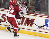 Joe Faust (Wisconsin - 24), Ryan Fitzgerald (BC - 19) - The Boston College Eagles defeated the visiting University of Wisconsin Badgers 9-2 on Friday, October 18, 2013, at Kelley Rink in Conte Forum in Chestnut Hill, Massachusetts.