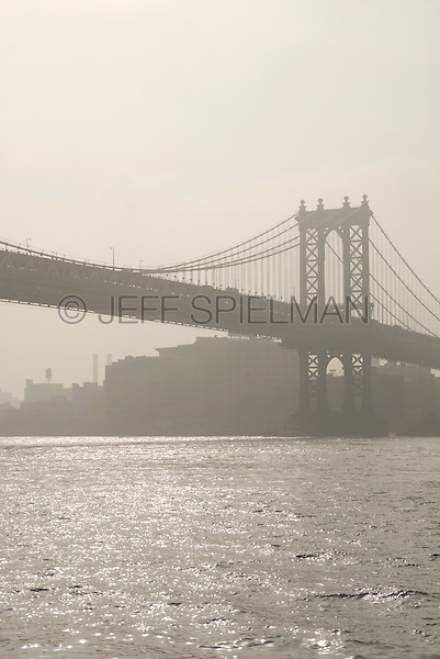 Manhattan Bridge, East River and DUMBO neighborhood of Brooklyn in the morning, viewed from Manhattan side of the East River, New York City, New York State, USA