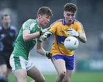 Adam O Connor of  Clare  in action against  Limerick during their Munster Minor football quarter final at  Cusack Park. Photograph by John Kelly.