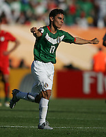 JUNE 11, 2006: Nuremberg, Germany: Mexican forward (19) Omar Bravo celebrates his goal during the World Cup Finals at Franken-Stadion in Nuremberg, Germany.  Mexico defeated Iran, 3-1.