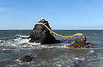 Meoto Iwa (夫婦岩) or the Loved one-and-loved one Rocks are a couple of small rocky stacks in the sea off Futami, Mie. They are joined by a shimenawa (a heavy rope of rice straw) and are considered sacred by worshippers at the neighbouring Futami Okitama Shrine (Futami Okitama Jinja (二見興玉神社)). Mie. Japan.<br />