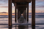 Scripps Pier, La Jolla, California; photographed at sunset with small waves coming ashore