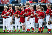 July 28, 2009:  A little league team line up for the national anthem before a game at Coca-Cola Field in Buffalo, NY.  Photo By Mike Janes/Four Seam Images