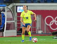 YOKOHAMA, JAPAN - AUGUST 6: Fridolina Rolfo #18 of Sweden controls the ball during a game between Canada and Sweden at International Stadium Yokohama on August 6, 2021 in Yokohama, Japan.