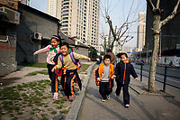 CHINA. Shanghai. Children running down the street. Shanghai is a sprawling metropolis or 15 million people situated in south-east China. It is regarded as the country's showcase in development and modernity in modern China. This rapid development and modernization, never seen before on such a scale has however spawned countless environmental and social problems. 2008