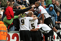 Pictured: (L-R) Craig Beattie, Alan Tate, Ashley Williams and Darren Pratley of Swansea City in action <br />