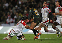 Friday 7th December 2012;  Nick Williams tackles Ken Pisi during the Pool 4 round 3 Heineken Cup clash at Franklin's Gardens, Northampton, England. Image credit -: JOHN DICKSON / DICKSONDIGITAL