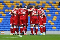 Crawley team huddle during AFC Wimbledon vs Crawley Town, Emirates FA Cup Football at Plough Lane on 29th November 2020