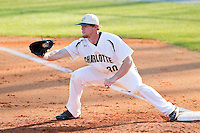 Charlotte 49ers first baseman Grant Dunnegan (30) stretches for a throw during the game against the Delaware State Hornets at Robert and Mariam Hayes Stadium on February 15, 2013 in Charlotte, North Carolina.  The 49ers defeated the Hornets 13-7.  (Brian Westerholt/Four Seam Images)