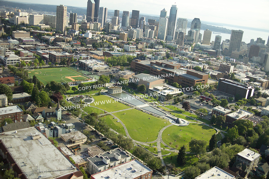 Late afternoon summer aerial photo looking towards the southwest of Cal Anderson Park in the Capitol Hill neighborhood of Seattle, WA, and the skyscrapers of downtown Seattle behind.  The park's grassy lawn areas are actually the lid on an important underground reservoir in the city's water supply.