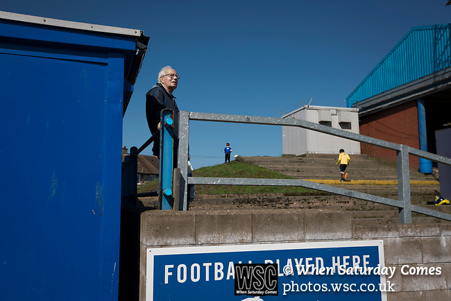 A home fan watching the first-half action at Palmerston Park, Dumfries as Queen of the South hosted Dundee United in a Scottish Championship fixture. The home has played at the same ground since its formation in 1919. Queens won the match 3-0 watched by a crowd of 1,531 spectators.
