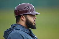 Devon Smith of the Concord Mountain Lions coaches third base during the game against the Wingate Bulldogs at Ron Christopher Stadium on February 1, 2020 in Wingate, North Carolina. The Bulldogs defeated the Mountain Lions 8-0 in game one of a doubleheader. (Brian Westerholt/Four Seam Images)