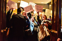 Montreal, CANADA, March 30, 2015. <br /> <br /> Protester dressed as business people inside the Bonaventure Hotel where<br />  Mr. Carlos Leitao, Minister of Finance and Member for Robert-Baldwin, speaks before the Board of Trade of Metropolitan Montreal<br /> <br />  Photo : Philippe Manh Nguyen - Agence Quebec Presse